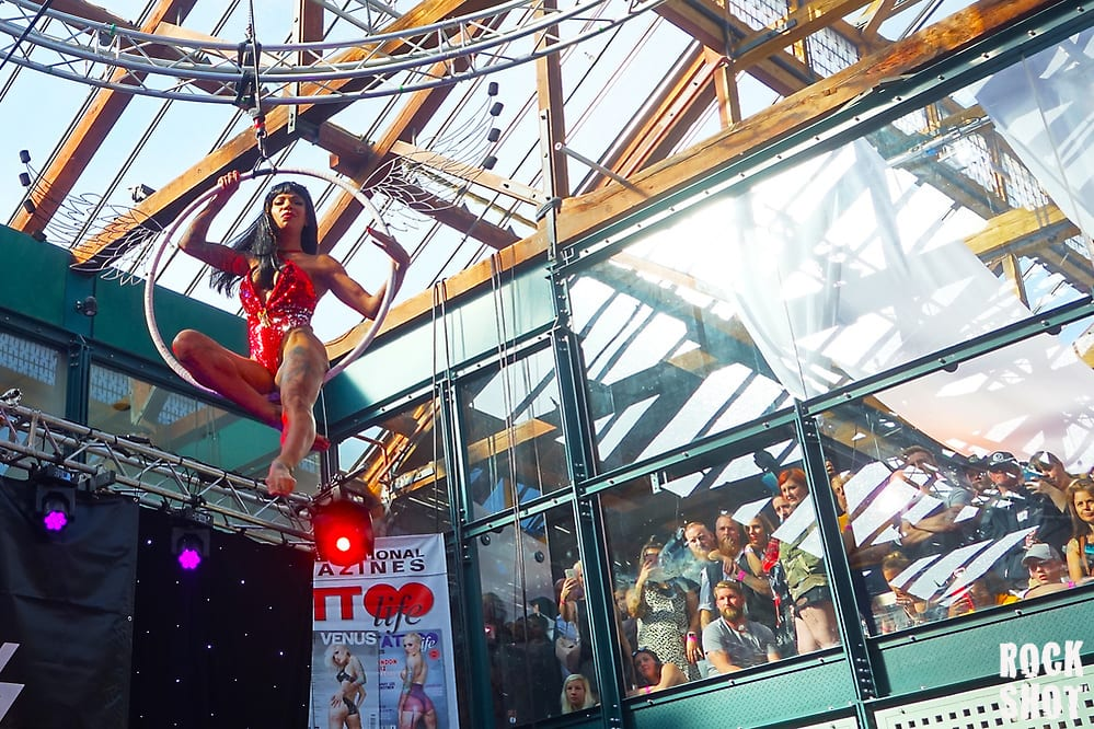 Swinging From Wooden Beams At London Tattoo Convention